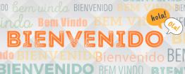 """Letreiro com a palavra """"Bienvenido"""" ao centro. Ao redor, a mesma palavra é escrita em português e espanhol."""